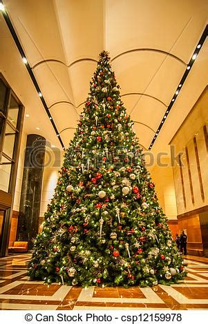 picture of decorated christmas tree indoor this dramatic
