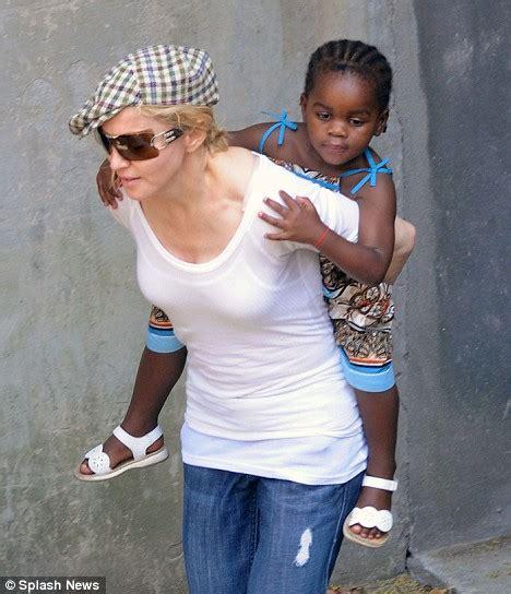 Doting New Mother Madonna Gives Mercy Piggyback Visit