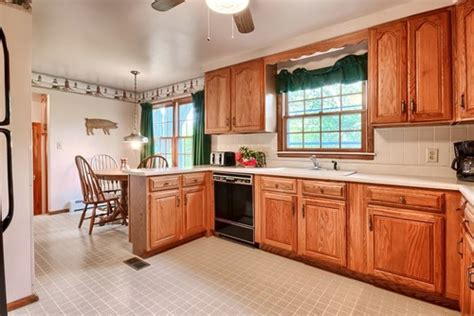 spruce up kitchen cabinets how to integrate dated oak kitchen cabinets without 8204