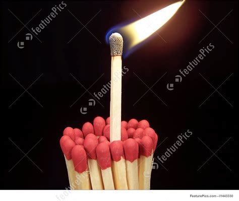 Lit Match Sticking Out Of Unlit Matches Stock Image