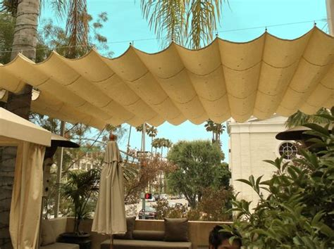 wire canopy awning retractable shade  backyard