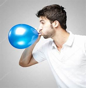 Man blowing balloon — Stock Photo © coolfonk #10178408  Blowing