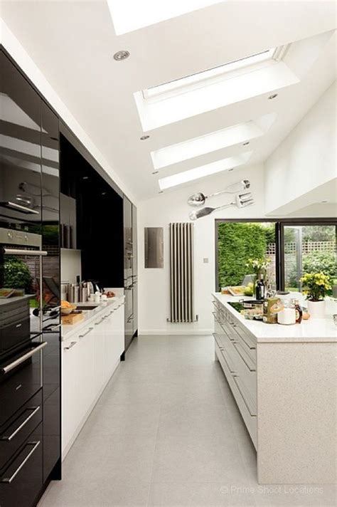 A Striking Contemporary Minimalist Kitchen With Central
