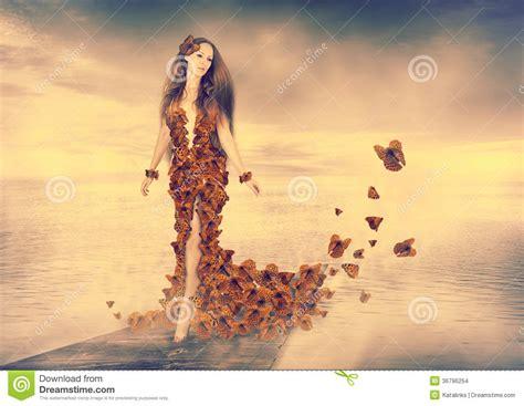 beautiful young woman  butterflies dress stock images