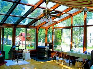 Dark stained, gabled sunroom with pellet stove traditional