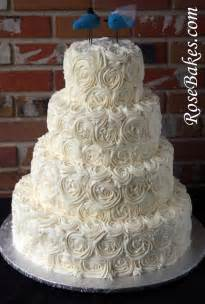 wedding cake with roses ivory buttercream roses wedding cake with lovebirds cake topper
