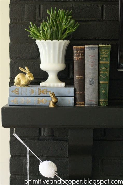Books For Decor - mantle with vintage touches and live greens brass