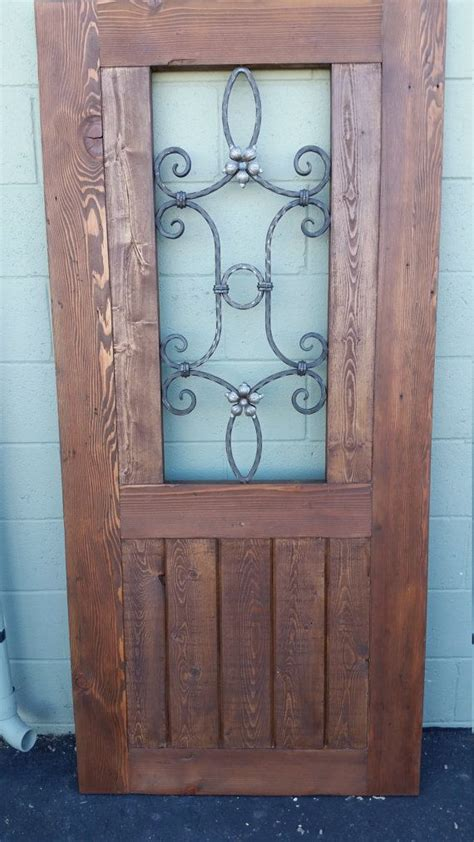 rustic reclaimed wood gate  wrought iron