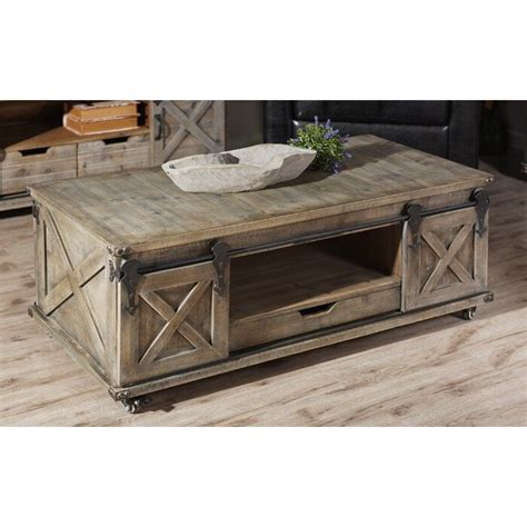 Coffee table with storage is essentially used for so many reasons. Magnus Solid Wood Wheel Coffee Table with Storage in 2020 | Door coffee tables, Coffee table ...