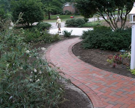 curved garden path think outside the square curved and round patios and walkways pine hall brick inc