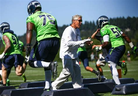 seahawks head coach pete carroll cheers  players