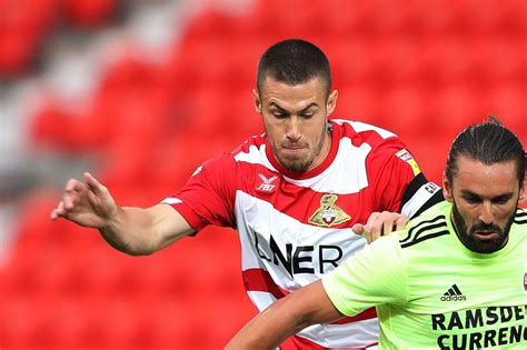 Doncaster Rovers: Tommy Rowe confident in promotion ...