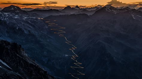 Mountain road Stelvio Pass curves at night with traffic ...