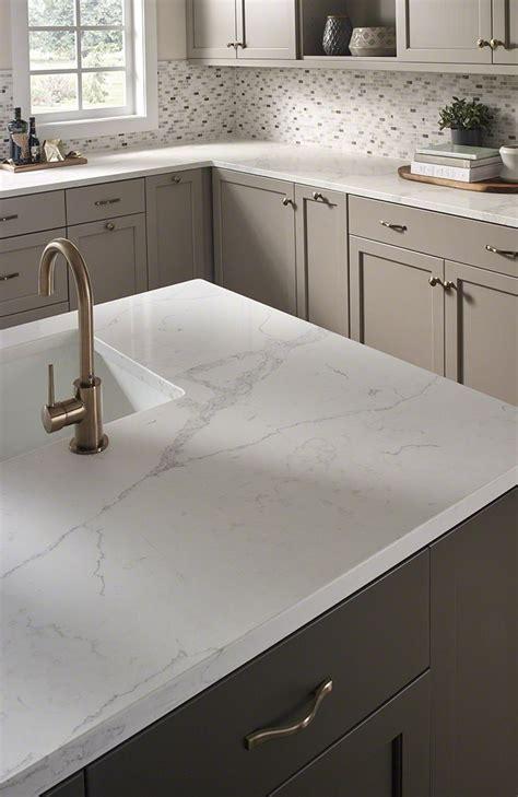 moonshine cabinets  carrara marmi quartz