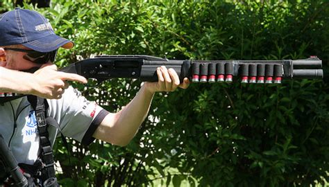 Dallin Hixson Shooting The Fnh Slp Mark I 12-gauge Shotgun