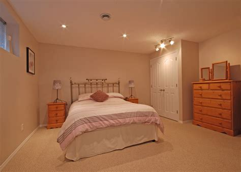 Modern Excellent White Basement Bedroom Design With Double Table Lamp And Wooden Drawer Ideas