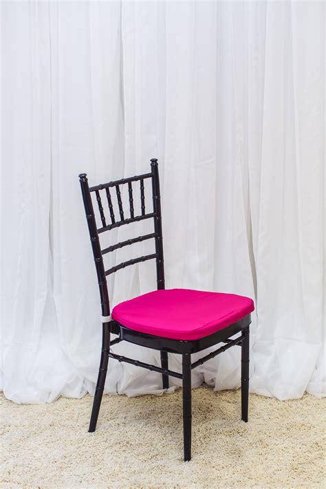 black chiavari chair pink cushion