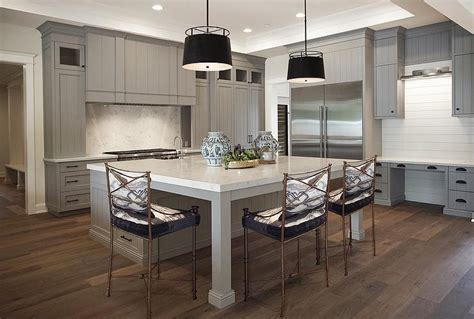 square kitchen island kitchen with inset wall tv contemporary kitchen