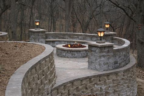 outdoor living with seat wall firepit retaining walls and lighting cm s backyard designs