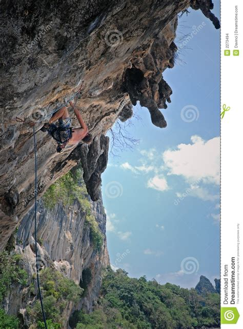 Man Climbing Cliff Stock Photo Image Hang Grab Grip