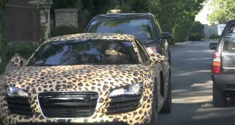 justin bieber   driving  leopard print audi