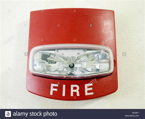 first alert smoke alarm blinking red light red fire alarm strobe light smoke detector mounted on a