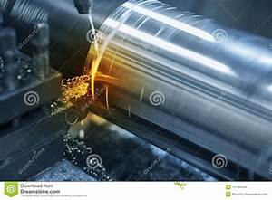The Lathe Machine Cutting The Steel Rod Stock Photo