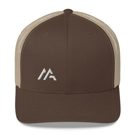 """You come in and get a covid vaccine here at pharm406, and you get a coffee. Mazevo Logo """"M"""" Trucker Cap"""