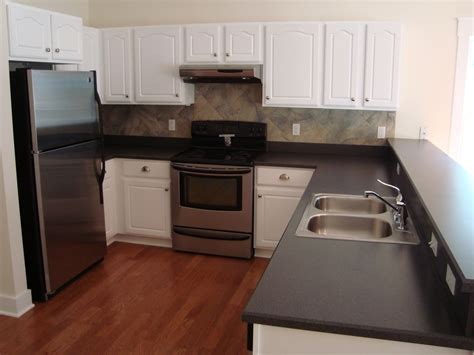 cabinet colors with stainless steel appliances love the slightly darker red tone floor with the white