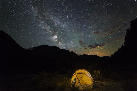Tent Stars And Illuminated Yellow Canding Tent Under Stars At