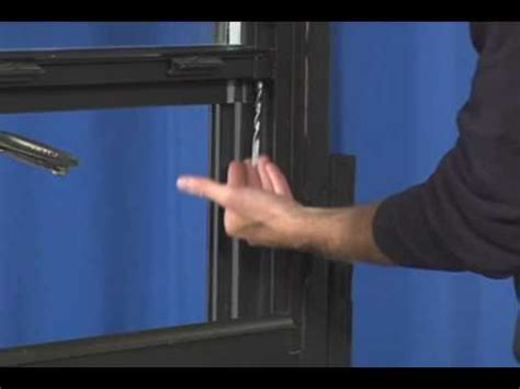window repair replacing  spiral window balance    tilting window youtube