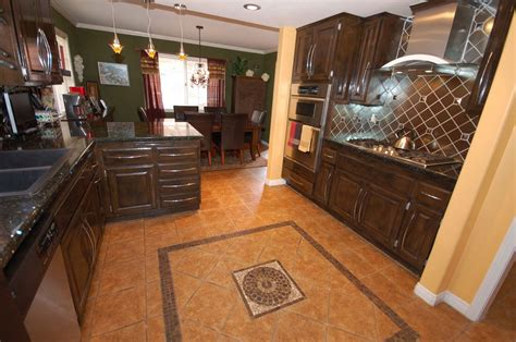 Using Decorative Tiles On The Kitchen Floor Will Make The