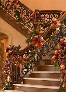 Gorgeous staircase decorated for Christmas in warm Fall