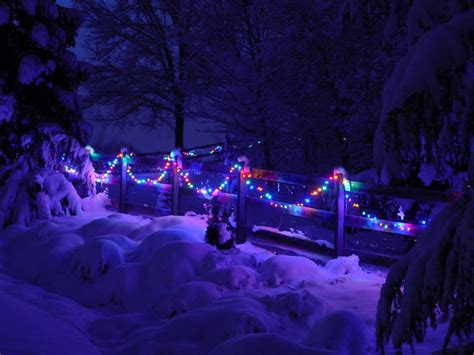 christmas lights that look like snow falling lights on blue snow scattered showers in a clear sky