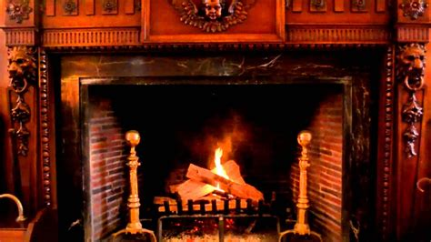 ornate handcrafted wood burning fireplace yule log