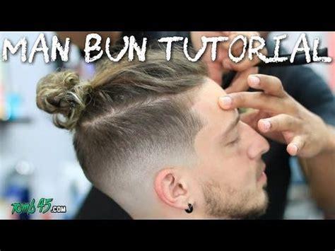 disconnected undercut man bun  bald skin fade