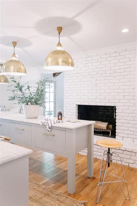 white  grey kitchen features  white brick fireplace