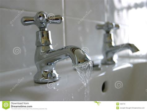 running water bathroom taps stock image image  silver