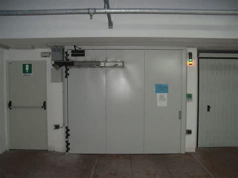 automatic garage door and fireplace industrial stop door by carmec