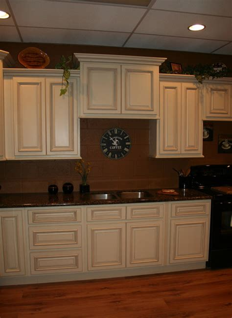 cream kitchen cabinets  black appliances home decorating ideas