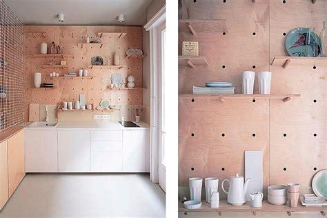 This Studio Apartment has a Beautiful Peg Board Storage Wall