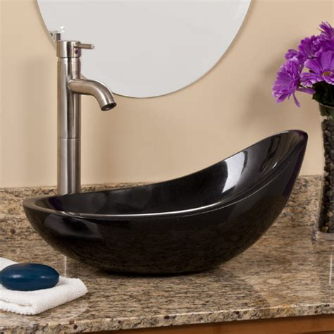 asymmetrical black granite vessel sink bathroom