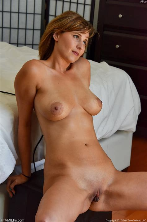 Busty Girl Alice Strips And Spreads Her Pussy In Looking