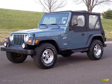 gunmetal blue jeep gunmetal pearl 1997 jeep wrangler sport 4x4 exterior photo