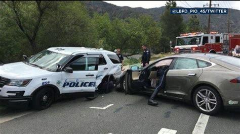 Tesla On Autopilot Crashes Into Parked Police Car Video