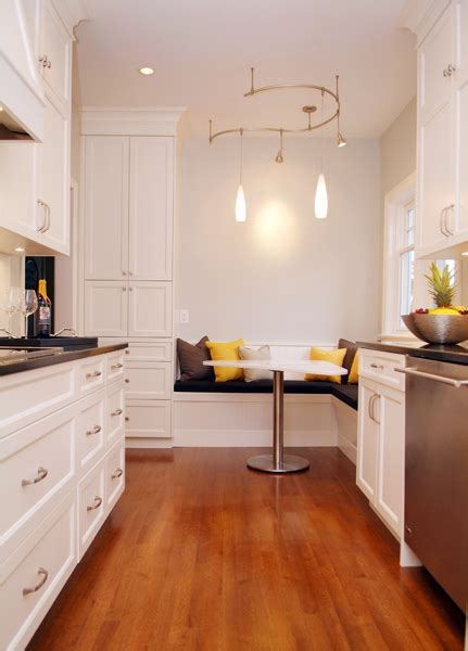 A hundred year old house gets a new galley kitchen. The