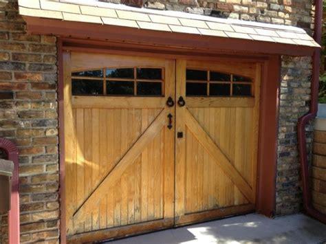 custom wood carriage garage door   refinish
