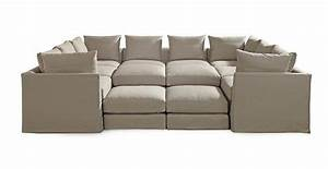 Dr pitt slipcovered sectional available online for Movie pit sectional sofa