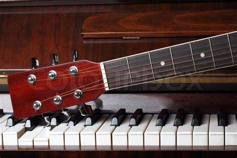 guitar neck   piano keys stock photo colourbox