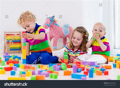 happy preschool age children play colorful stock photo 514 | stock photo happy preschool age children play with colorful plastic toy blocks creative kindergarten kids 458346562